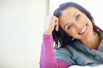 A woman with healthy teeth smiling